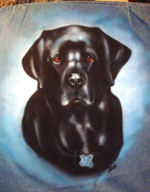 black lab portrait on denim jacket