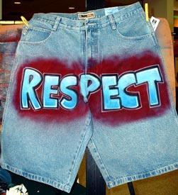 airbrush lettering on denim shorts